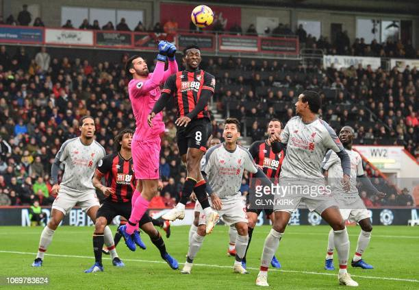 Liverpool's Brazilian goalkeeper Alisson Becker comes out to punch under pressure from Bournemouth's Colombian midfielder Jefferson Lerma during the...