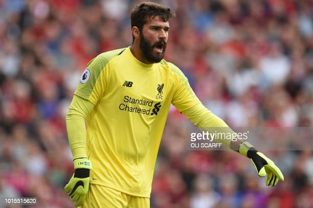 Liverpool's Brazilian goalkeeper Alisson Becker gestures during the English Premier League football match between Liverpool and West Ham United at...