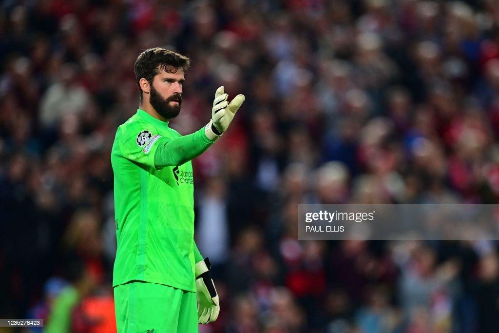 Liverpool's Brazilian goalkeeper Alisson Becker gestures ...