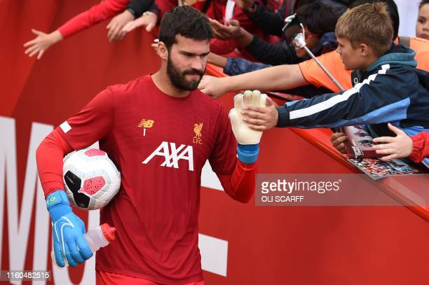 Liverpool's Brazilian goalkeeper Alisson Becker greets fans before the English Premier League football match between Liverpool and Norwich City at...