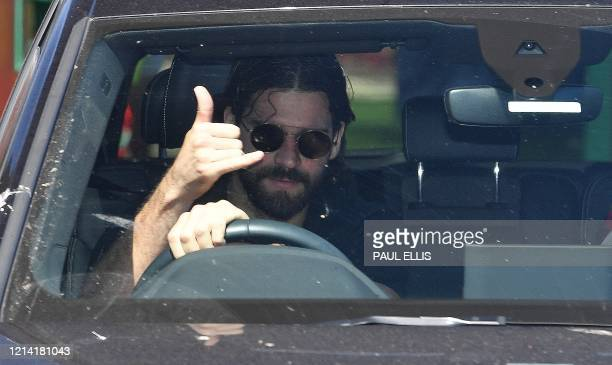 Liverpool's Brazilian goalkeeper Alisson Becker leaves Melwood in Liverpool north west England after training on May 20 as training resumes after the...