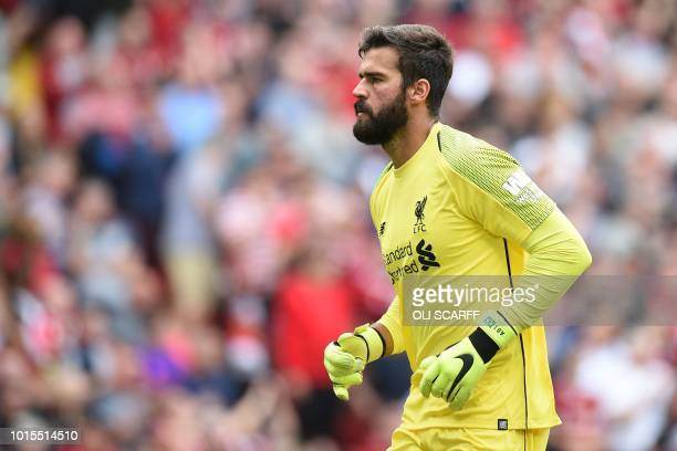 Liverpool's Brazilian goalkeeper Alisson Becker makes his Premier League debut during the English Premier League football match between Liverpool and...