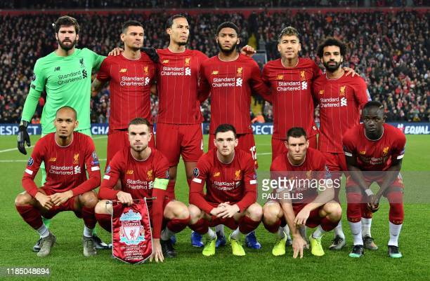 Liverpool's Brazilian goalkeeper Alisson Becker pose for a photo with teammates ahead of the UEFA Champions league Group E football match between...