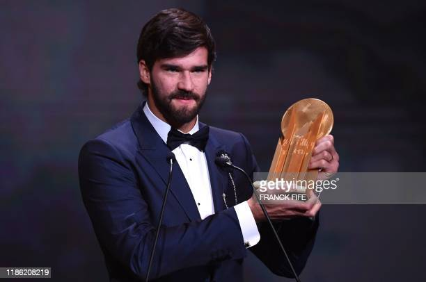 Liverpool's Brazilian goalkeeper Alisson Becker reacts after winning the Yachine trophy for best goalkeeper of the world during the Ballon d'Or...
