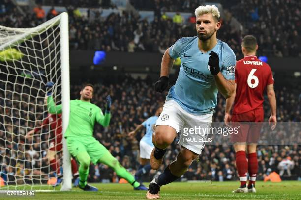 Liverpool's Brazilian goalkeeper Alisson Becker reacts as Manchester City's Argentinian striker Sergio Aguero celebrates after scoring the opening...