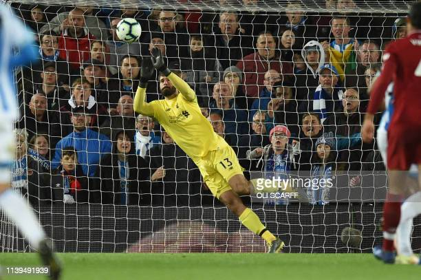 Liverpool's Brazilian goalkeeper Alisson Becker saves a shot at goal during the English Premier League football match between Liverpool and...
