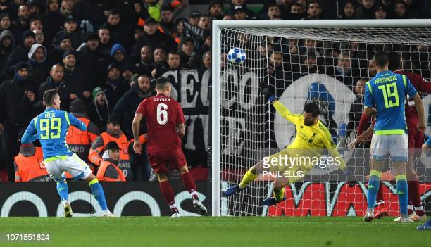 Liverpool's Brazilian goalkeeper Alisson Becker saves a shot from Napoli's Polish striker Arkadiusz Milik during the UEFA Champions League group C...
