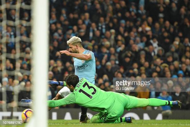 Liverpool's Brazilian goalkeeper Alisson Becker saves at the feet of Manchester City's Argentinian striker Sergio Aguero during the English Premier...