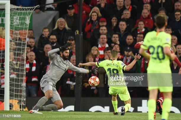 Liverpool's Brazilian goalkeeper Alisson Becker saves from Barcelona's Spanish defender Jordi Alba during the UEFA Champions league semifinal second...