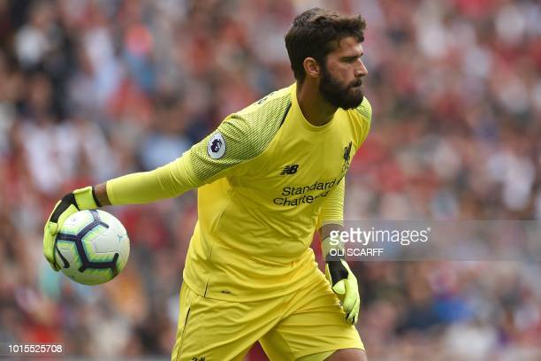 Liverpool's Brazilian goalkeeper Alisson Becker throws the ball out during the English Premier League football match between Liverpool and West Ham...
