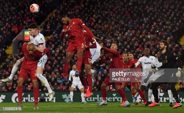 Liverpool's Brazilian goalkeeper Alisson Becker watches as Liverpool's Dutch midfielder Georginio Wijnaldum defends the ball during a corner kick...