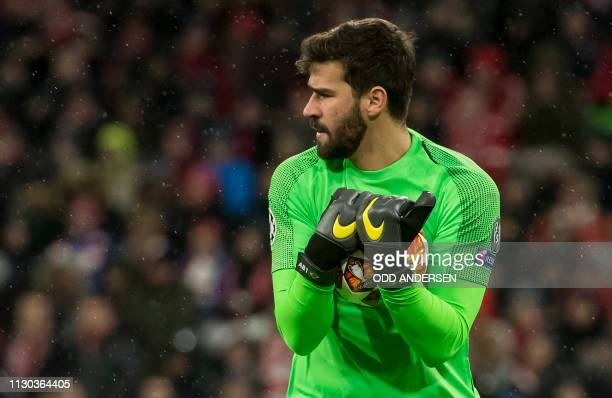 Liverpool's Brazilian goalkeeper Alisson makes a save during the UEFA Champions League last 16 second leg football match Bayern Munich v Liverpool in...