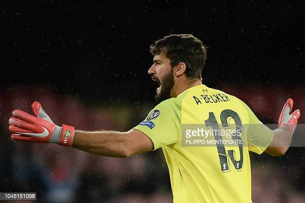 Liverpool's Brazilian goalkeeper Alisson reacts during the UEFA Champions League group C football match between Napoli and Liverpool on October 3...