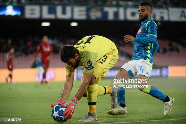 Liverpool's Brazilian goalkeeper Alisson secures the ball under pressure from Napoli's Italian forward Lorenzo Insigne during the UEFA Champions...