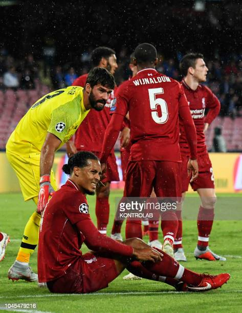 STADIUM NAPLES CAMPANIA ITALY Liverpool's Brazilian goalkeeper Allison Becker and Liverpool's Dutch defender Virgil van Dijk react after Napoli's...