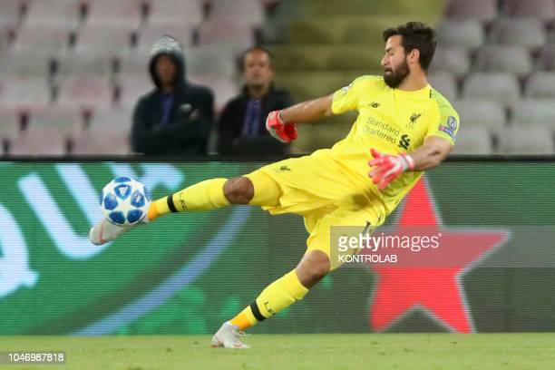 STADIUM NAPLES CAMPANIA ITALY Liverpool's Brazilian goalkeeper Allison Becker kicks the ball during the UEFA Champions League football match SSC...