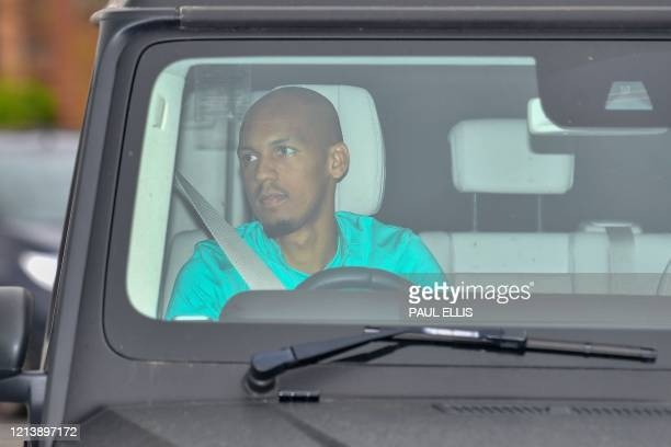Liverpool's Brazilian midfielder Fabinho arrives at Melwood in Liverpool north west England for a training session on May 19 as training resumes for...
