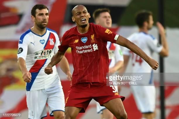 Liverpool's Brazilian midfielder Fabinho celebrates scoring his team's third goal during the English Premier League football match between Liverpool...