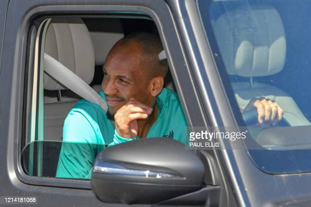 Liverpool's Brazilian midfielder Fabinho leaves Melwood in Liverpool north west England after training on May 20 as training resumes after the...