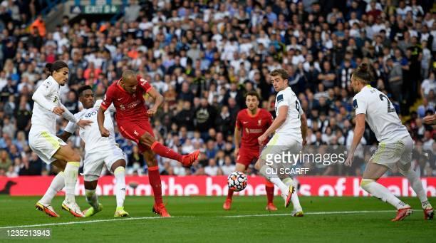 Liverpool's Brazilian midfielder Fabinho shoots to score his team's second goal during the English Premier League football match between Leeds United...