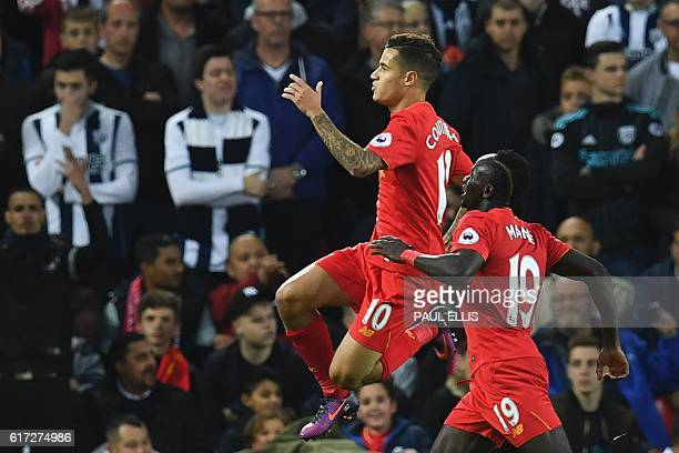 Liverpool's Brazilian midfielder Philippe Coutinho celebrates scoring their second goal with Liverpool's Senegalese midfielder Sadio Mane during the...