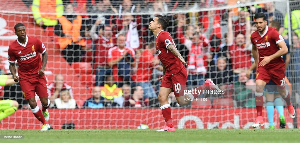 Liverpool's Brazilian midfielder Philippe Coutinho (C) celebrates scoring his team's second goal during the English Premier League football match between Liverpool and Middlesbrough at Anfield in Liverpool, north west England on May 21, 2017. / AFP PHOTO / Paul ELLIS / RESTRICTED TO EDITORIAL USE. No use with unauthorized audio, video, data, fixture lists, club/league logos or 'live' services. Online in-match use limited to 75 images, no video emulation. No use in betting, games or single club/league/player publications. /
