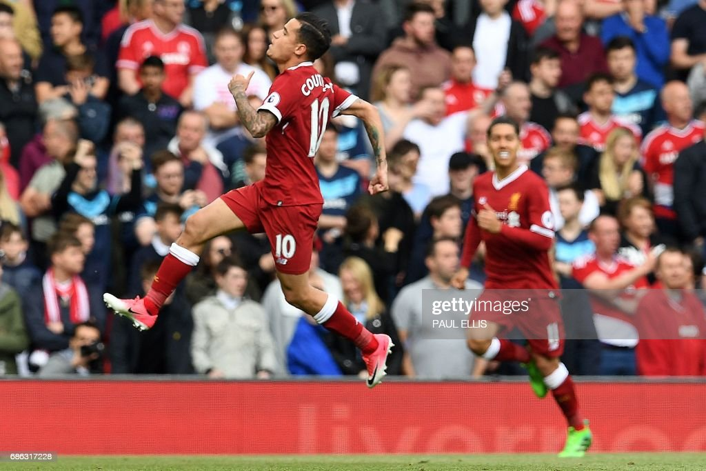 Liverpool's Brazilian midfielder Philippe Coutinho celebrates scoring his team's second goal during the English Premier League football match between Liverpool and Middlesbrough at Anfield in Liverpool, north west England on May 21, 2017. / AFP PHOTO / Paul ELLIS / RESTRICTED TO EDITORIAL USE. No use with unauthorized audio, video, data, fixture lists, club/league logos or 'live' services. Online in-match use limited to 75 images, no video emulation. No use in betting, games or single club/league/player publications. /