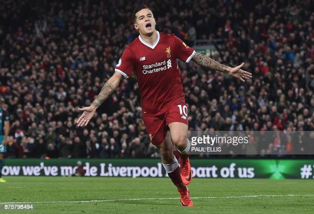 Liverpool's Brazilian midfielder Philippe Coutinho celebrates scoring his team's third goal during the English Premier League football match between...