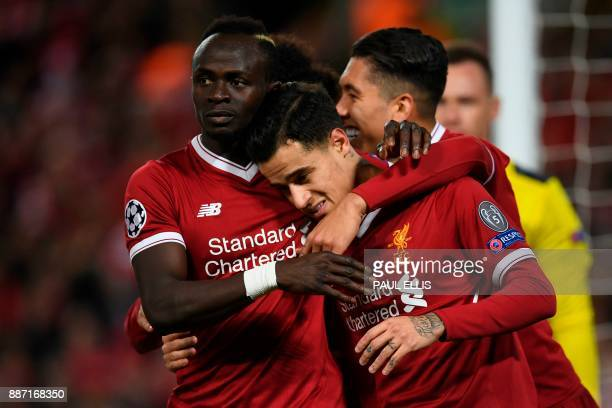 Liverpool's Brazilian midfielder Philippe Coutinho celebrates scoring their fifth goal and completing his hattrick with Liverpool's Brazilian...