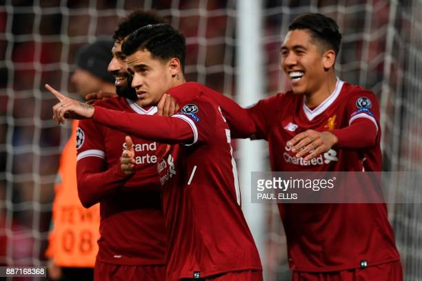 Liverpool's Brazilian midfielder Philippe Coutinho celebrates scoring their fifth goal and completing his hattrick with Liverpool's Egyptian...
