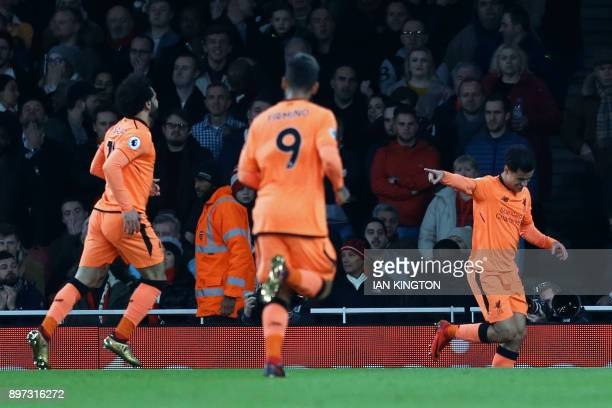 Liverpool's Brazilian midfielder Philippe Coutinho celebrates scoring the team's first goal with Liverpool's Egyptian midfielder Mohamed Salah and...