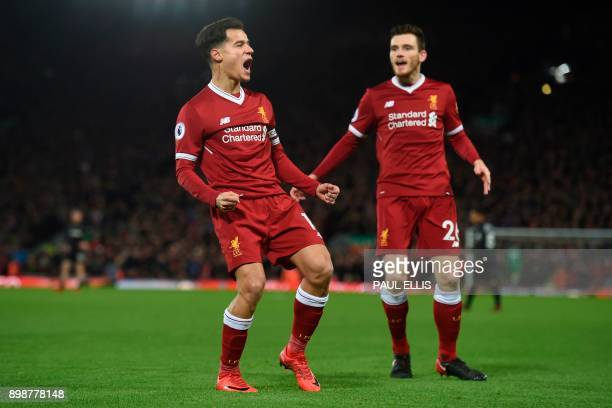 Liverpool's Brazilian midfielder Philippe Coutinho celebrates scoring the English Premier League football match between Liverpool and Swansea City at...