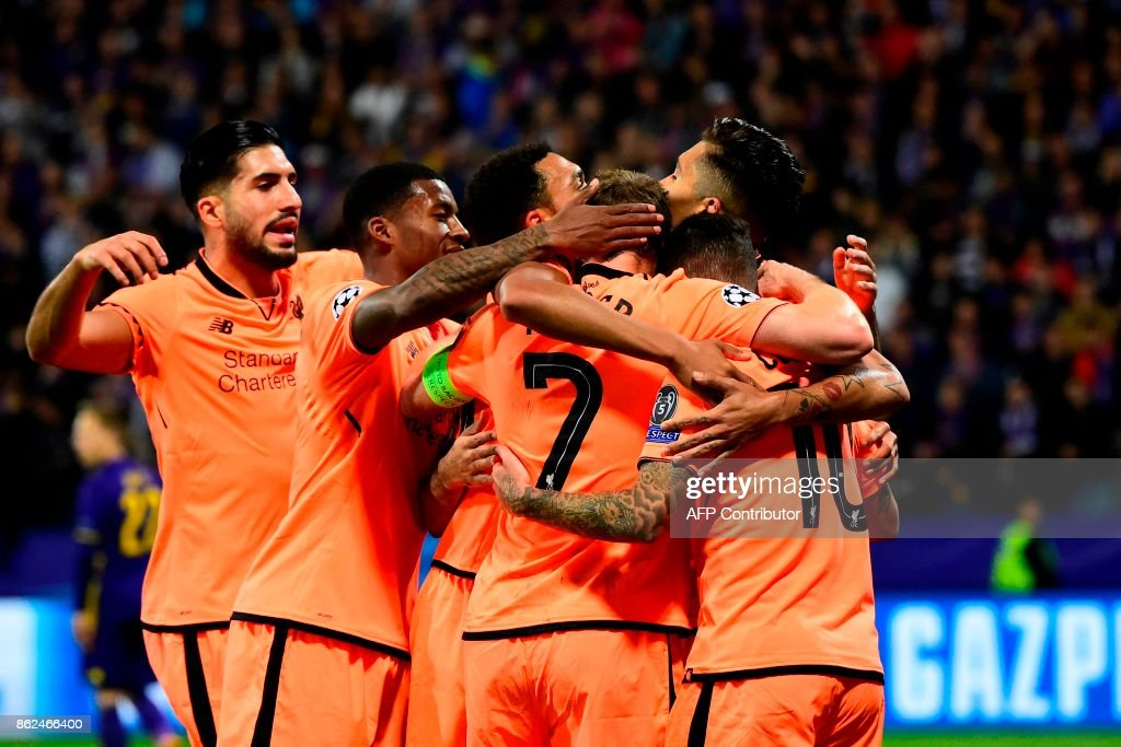 Liverpool's Brazilian midfielder Philippe Coutinho (R) celebrates with teammates after scoring a goal during the UEFA Champions League group E football match between NK Maribor and Liverpool at the Ljudski vrt Stadium, in Maribor, on October 17, 2017. / AFP PHOTO / Jure Makovec