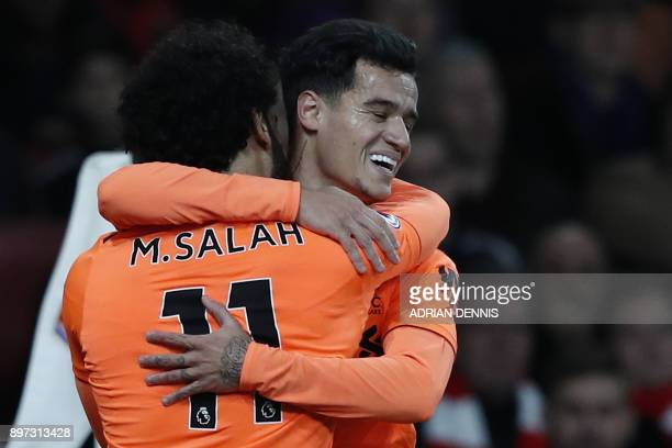 Liverpool's Brazilian midfielder Philippe Coutinho celebrates with Liverpool's Egyptian midfielder Mohamed Salah after scoring the team's first goal...