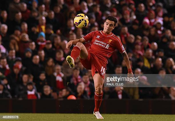 Liverpool's Brazilian midfielder Philippe Coutinho controls the ball during the English Premier League football match between Liverpool and Swansea...