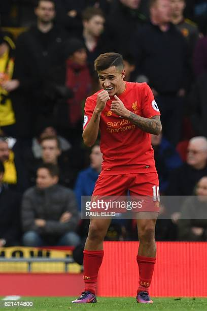 Liverpool's Brazilian midfielder Philippe Coutinho dances as he celebrates scoring his team's second goal during the English Premier League football...