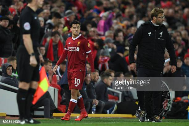 Liverpool's Brazilian midfielder Philippe Coutinho is substituted as Liverpool's German manager Jurgen Klopp gestures during the English Premier...