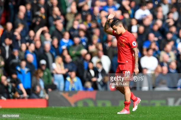 Liverpool's Brazilian midfielder Philippe Coutinho leaves the pitch substituted during the English Premier League football match between Liverpool...