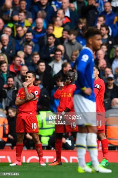 Liverpool's Brazilian midfielder Philippe Coutinho Liverpool's Senegalese midfielder Sadio Mane and Liverpool's Brazilian midfielder Roberto Firmino...
