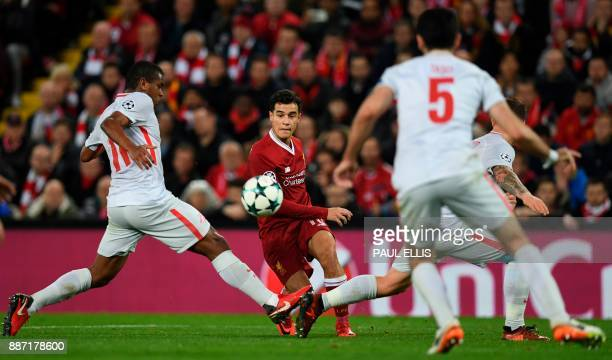 Liverpool's Brazilian midfielder Philippe Coutinho plays the ball between Spartak Moscow's Brazilian midfielder Fernando and Spartak Moscow's German...