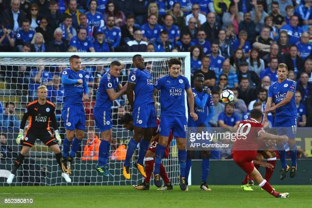 Liverpool's Brazilian midfielder Philippe Coutinho scores their second goal with this freekick during the English Premier League football match...