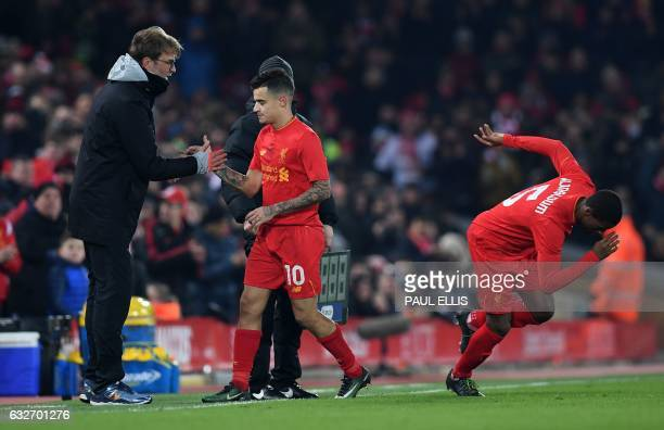 Liverpool's Brazilian midfielder Philippe Coutinho shakes hands with Liverpool's German manager Jurgen Klopp after being substituted off for...