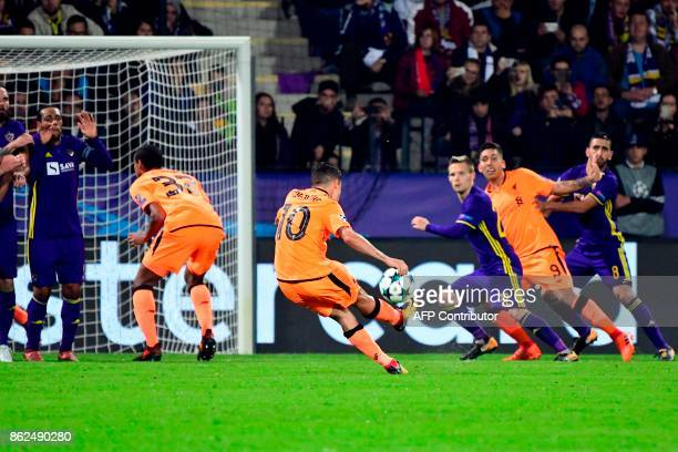Liverpool's Brazilian midfielder Philippe Coutinho shoots the ball during the UEFA Champions League group E football match between NK Maribor and...