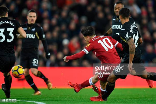 Liverpool's Brazilian midfielder Philippe Coutinho shoots to score the opening goal of the English Premier League football match between Liverpool...