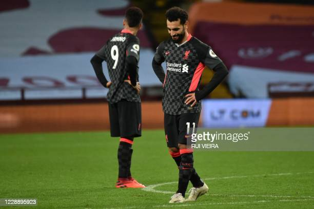 Liverpool's Brazilian midfielder Roberto Firmino and Liverpool's Egyptian midfielder Mohamed Salah react to conceding their sixth goal during the...