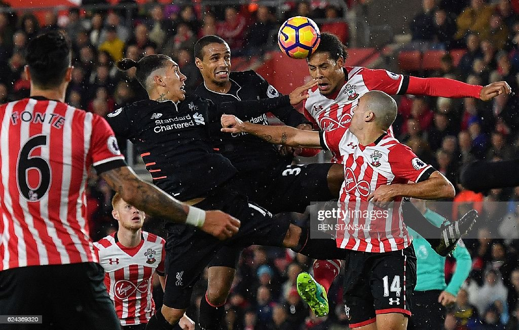 Liverpool's Brazilian midfielder Roberto Firmino (L) and Liverpool's German-born Cameroonian defender Joel Matip (2L) vie in the air with Southampton's Dutch defender Virgil van Dijk (2R) and Southampton's Sepanish midfielder Oriol Romeu during the English Premier League football match between Southampton and Liverpool at St Mary's Stadium in Southampton, southern England on November 19, 2016. / AFP / BEN STANSALL / RESTRICTED TO EDITORIAL USE. No use with unauthorized audio, video, data, fixture lists, club/league logos or 'live' services. Online in-match use limited to 75 images, no video emulation. No use in betting, games or single club/league/player publications. /