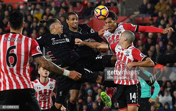 Liverpool's Brazilian midfielder Roberto Firmino and Liverpool's Germanborn Cameroonian defender Joel Matip vie in the air with Southampton's Dutch...