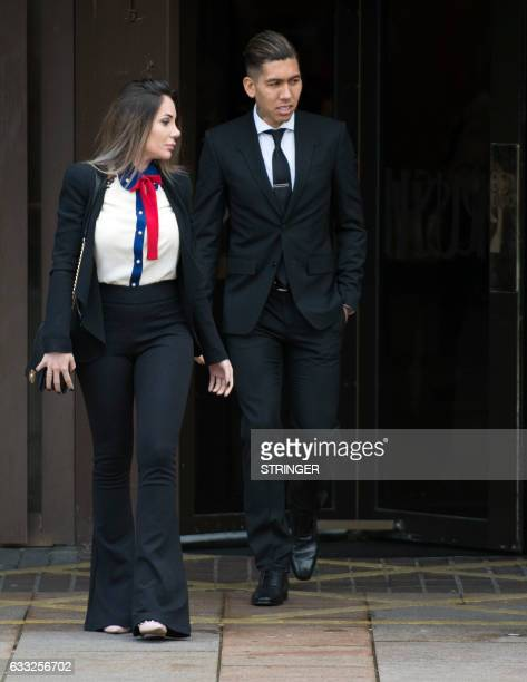 Liverpool's Brazilian midfielder Roberto Firmino and wife Larissa Pereira leave Liverpool Magistrates Court in Liverpool northwest England on...