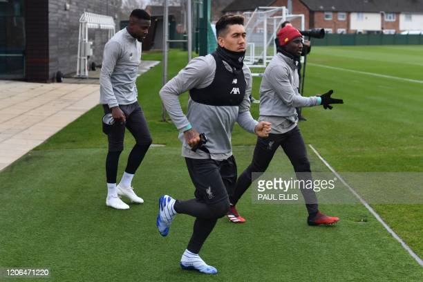 Liverpool's Brazilian midfielder Roberto Firmino attends a training session at Melwood in Liverpool north west England on March 10 on the eve of...