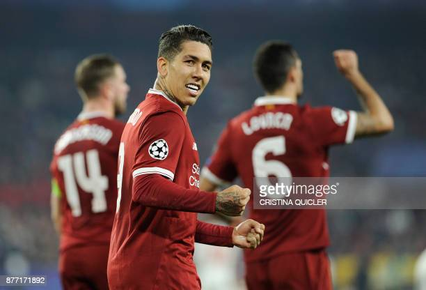 Liverpool's Brazilian midfielder Roberto Firmino celebrates after scoring a goal on November 21 2017 at the Ramon Sanchez Pizjuan stadium in Sevilla...